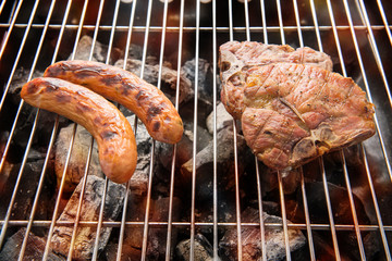 BBQ sausages and meat on the grill