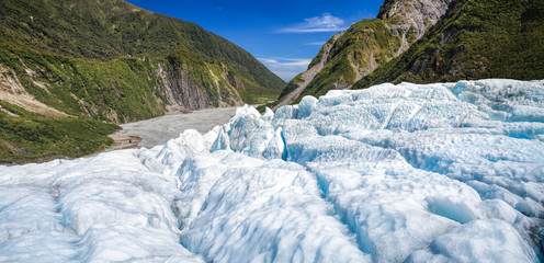 Blue ice of Fox Glacier in South Island of New Zealand panorama