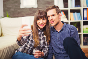 Marriage or couple laughing and taking a selfie with phone