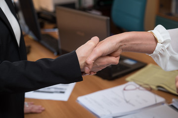 conclusion of a deal between two women
