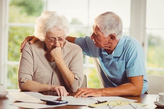 Senior couple counting bills