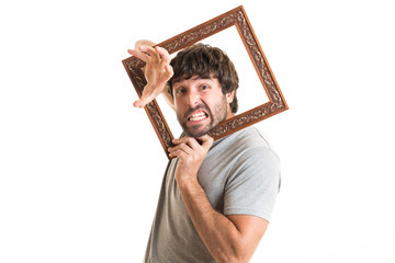 Portrait of a joking man holding picture frame