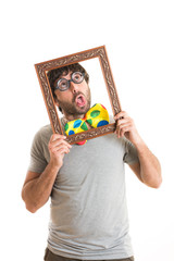 Portrait of a crazy man holding picture frame
