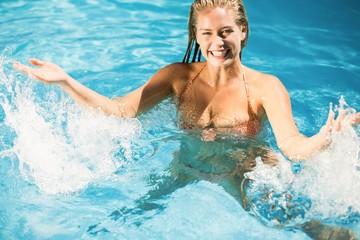 Beautiful woman enjoying in swimming pool