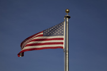 The American flag blowing in the wind