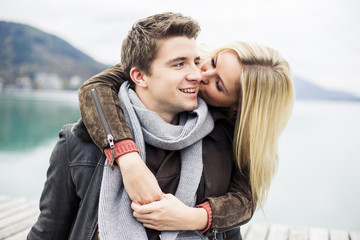 Young couple kissing on a lake