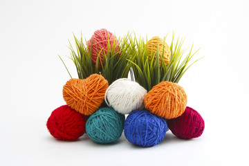 Isolated Colorful decorated easter eggs from wool yarn.