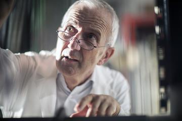 Portrait of man controlling device