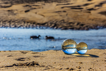 Crystal balls on the river side