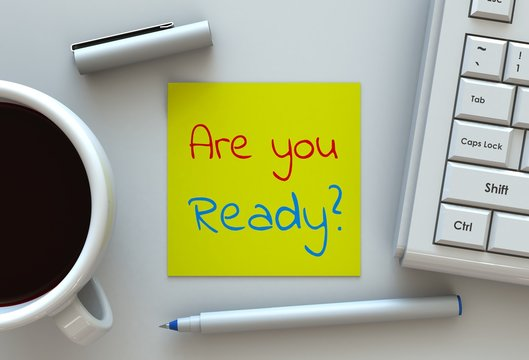 Are you Ready, message on note paper, computer and coffee on table
