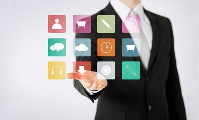 close up of man showing application menu icons