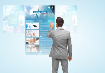 man with virtual projection of business news