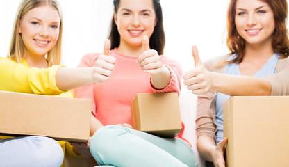 close up of teenage girls with cardboard box