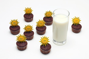 Milk and chocolate muffins with sun decoration, isolated on white background