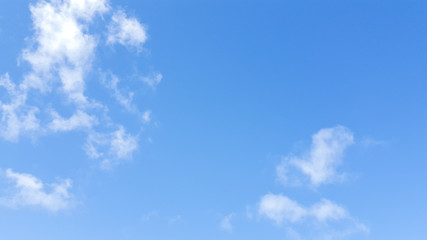 White cloudy and blue background