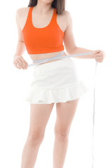 young woman measuring waist on white background