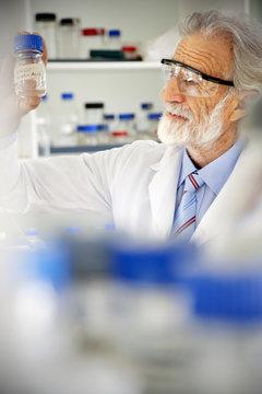 Senior professor looking at laboratory glass