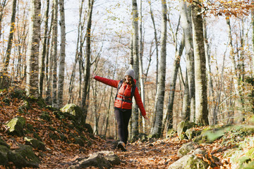 Spain, Catalunya, Girona, female hiker walking in the woods