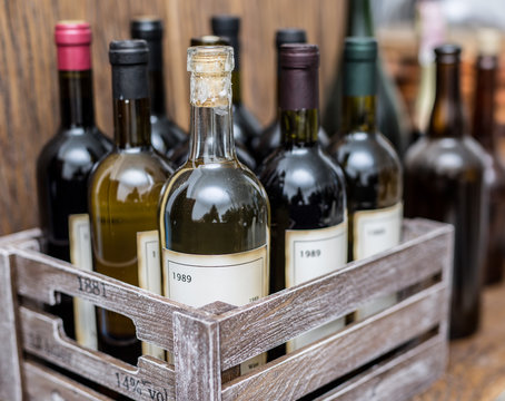 Wine bottles in a wooden crate .