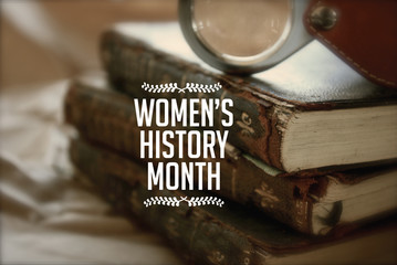 Women's history month photo with antique books.