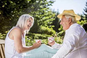 Happy elderly couple in garden