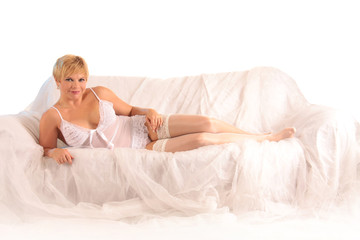 blonde girl on white sofa