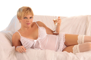 blonde girl with champagne on sofa