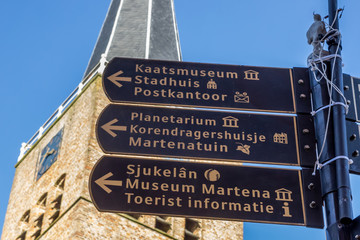 Fototapete - Tourist sign in front of the Martini church in Franeker