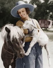 Woman with goat and pony