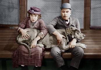 Couple with big dog on laps