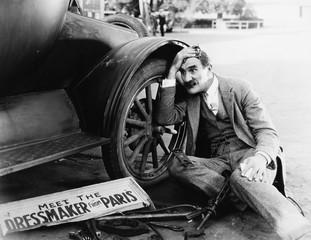 Man trying to fix broken car