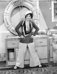 Woman in a sailors outfit in front of a life preserver