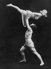Male dancer holding female dancer aloft