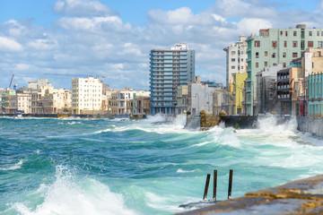 The Havana skyline with big waves on the sea