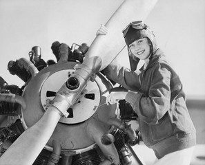 Portrait of woman with plane propeller
