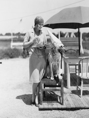 Woman with dog wearing hat and glasses