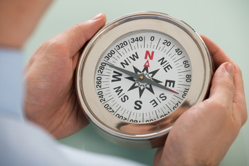 Person Hand With Compass