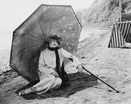Woman with umbrella at beach