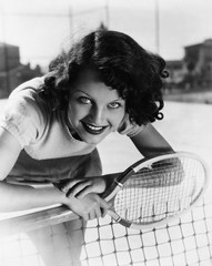 Portrait of female tennis player at the net