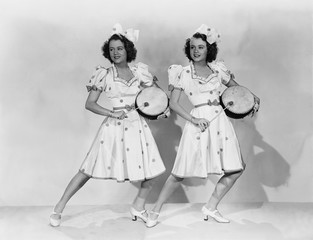 Women in matching outfits playing drums