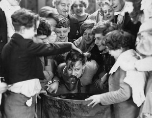 Children crowded around apple bobbing