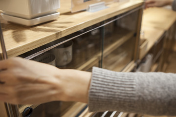 Women are measured the size of the cupboard in the furniture store's