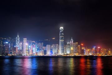 Night view of Hong Kong Island skyline across Victoria harbor