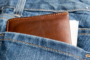 Leather wallet and money  on jean background