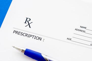 Medical prescription and pen.