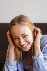 Portrait of young blonde girl smiling
