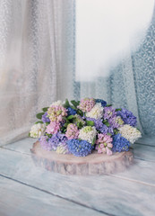bouquet of hyacinth on wooden boards
