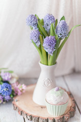 vase with a large bouquet of hyacinth