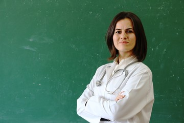 Woman Doctor is smiling.