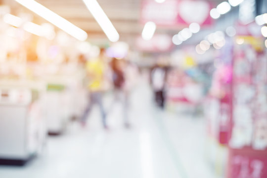 Abstract blurred interior of supermarket with people shopping background - vintage retro color filter